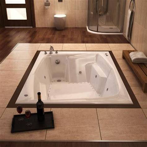 A Guide to In Floor Tubs for a Dream Spa Style Bathroom is
